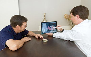 Dr. Field showing patient implant on ipad